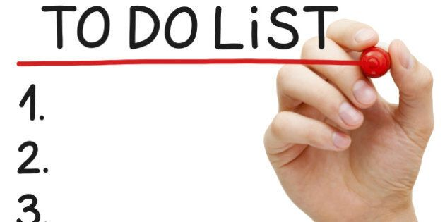 Hand underlining To Do List with red marker isolated on