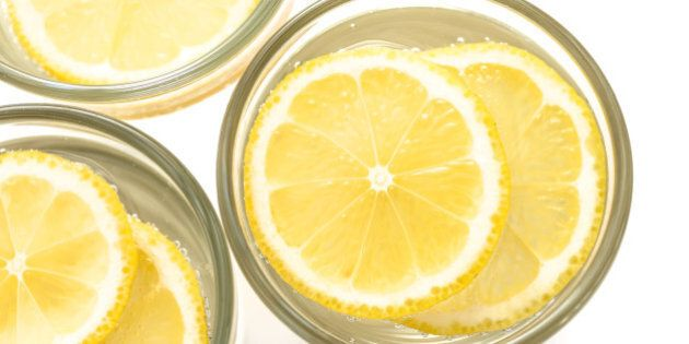 Sparcling water glass with lemon, view from the