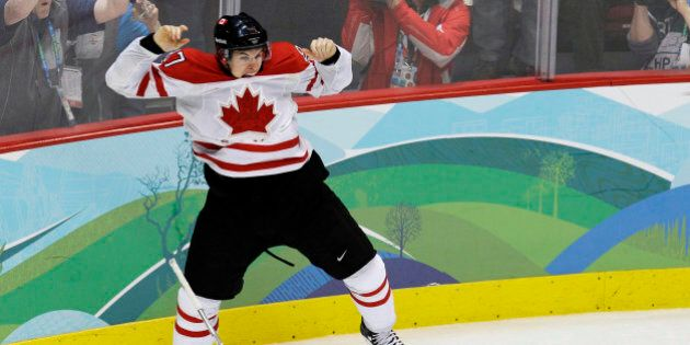 FILE - In this Feb. 28, 2010, file photo, Canada's Sidney Crosby (87) leaps in the air after making the...