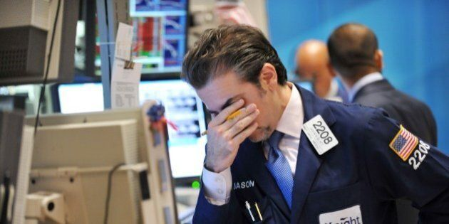 Jason Blatt of Knight Capital Americas, LP reacts to down market on the floor of the New York Stock Exchange...