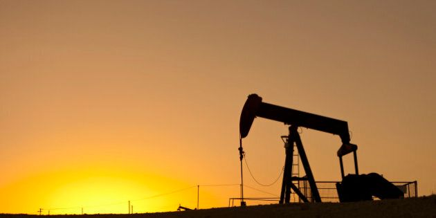 Oil pump working in an extensive oil field at