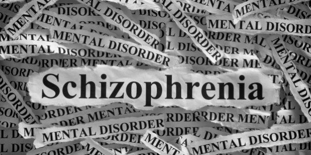 Schizophrenia. Torn pieces of paper with the word Schizophrenia and mental disorder. Concept Image. Black...