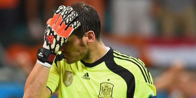 SALVADOR, BRAZIL - JUNE 13: Iker Casillas of Spain reacts after allowing the Netherlands fourth goal...
