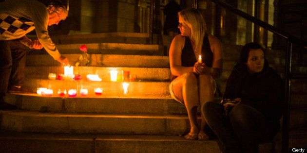 LAC-MEGANTIC, CANADA - JULY 13: Local residents during a candle-lit vigil, at the Presbytres-Eglises...