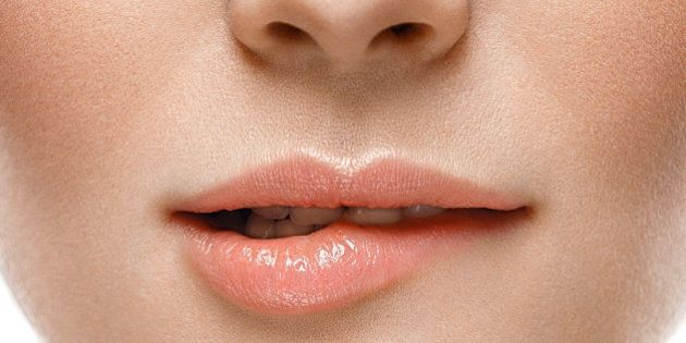 Healthy Smile. Woman Smile Closeup. Beautiful Lips Healthy skin concept. Studio
