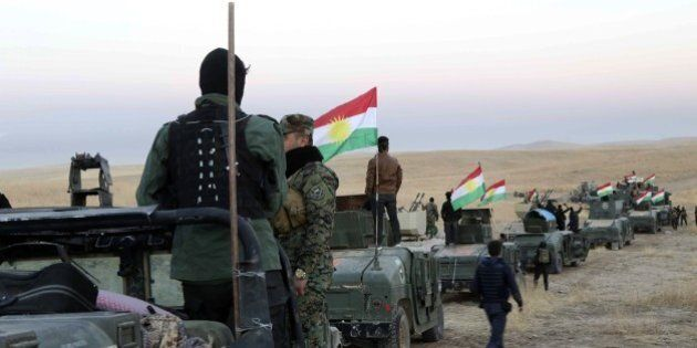 MOSUL, IRAQ - OCTOBER 17 : Peshmerga forces dispatch tanks and armored vehicles to Rabia and Karbali...
