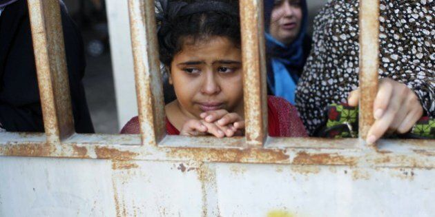 A young girl mourns during the funeral of at least 9 members of the same al-Ghul family who died after...