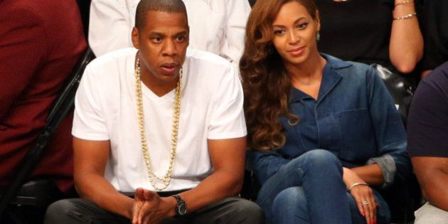 May 12, 2014; Brooklyn, NY, USA; Jay Z and Beyonce sit court side during the third quarter of the game...