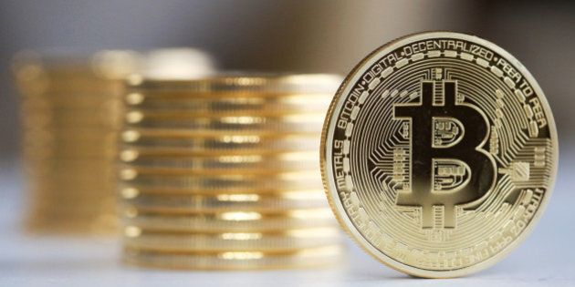 A single Bitcoin stands in front of a collection of Bitcoins in this arranged photograph in Danbury,...