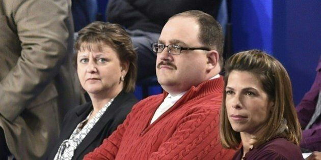 (FILES) In this file photo dated October 9, 2016 Ken Bone (C) listens to US Democratic nominee Hillary Clinton and Republican nominee Donald Trump during the second presidential debate at Washington University in St. Louis, Missouri. As the mud flew at Donald Trump and Hillary Clinton's second presidential debate Sunday, the American everyman became an instant celebrity by calmly asking a question about energy policy. Bone -- even his sturdy name has been a source of amusement on social media -- had been picked to represent undecided voters at the town hall-style debate in St Louis, Missouri. His heft, poise and polite manner offered a brief but refreshing respite from the 90-minute slug-fest between the Republican and Democratic candidates. / AFP / POOL / Paul J. Richards / TO GO WITH AFP STORY 'Ken Bone, everyman hero in a tawdry US campaign'        (Photo credit should read PAUL J. RICHARDS/AFP/Getty Images)