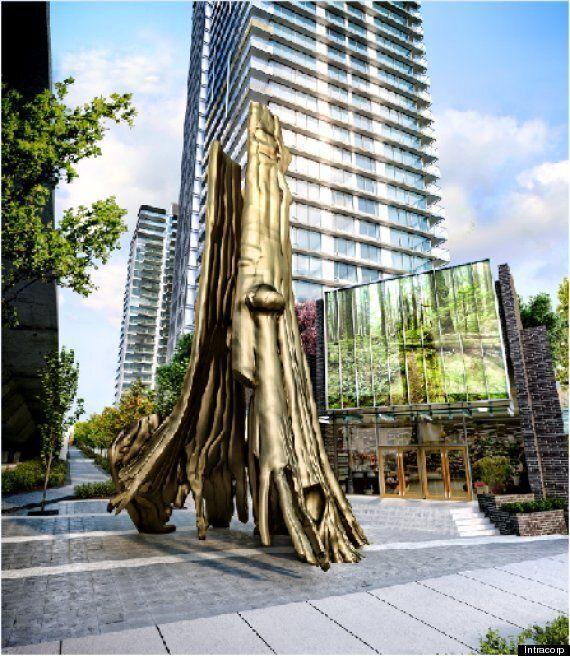 Douglas Coupland Designs Gold Hollow Tree Replica In Vancouver