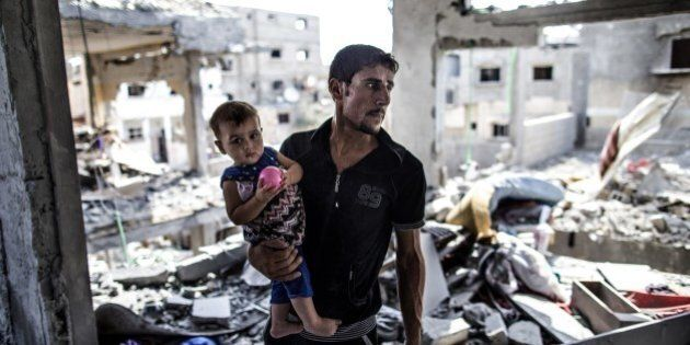 A Palestinian man looks on while standing in what remains of his house in part of the northern Beit Hanun district of the Gaza Strip after a 72-hour truce accepted by Israel and Hamas came into effect on August 5, 2014. Israel and Hamas said they have agreed a new 72-hour truce, after increasingly vocal international demands for a ceasefire in the bloody 29-day-old Gaza conflict. AFP PHOTO/MARCO LONGARI        (Photo credit should read MARCO LONGARI/AFP/Getty Images)