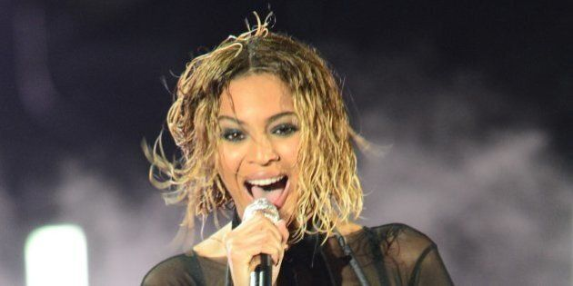 Beyonce Knowles performs on stage for the 56th Grammy Awards at the Staples Center in Los Angeles, California,...