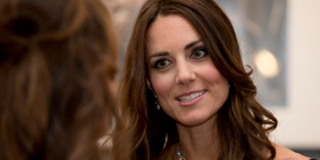 Kate Duchess of Cambridge talks to guests at a fund raising gala at the National Portrait Gallery in...