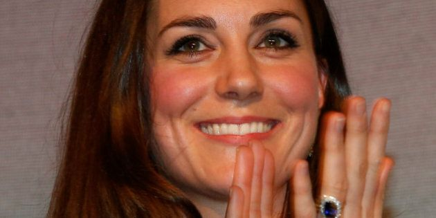 Britain's Duchess of Cambridge, left, Patron of SportsAid charity, applauds shooter Amber Hill, 16, after...