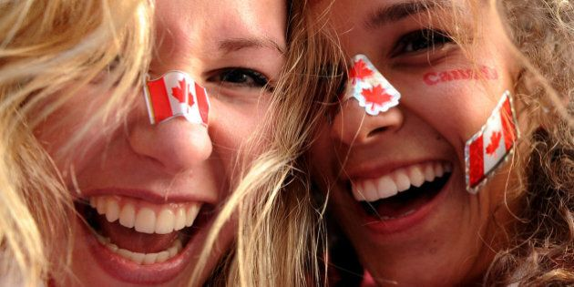 Canada supporters celebrate in downtown Vancouver following the Canadian's ice hockey team's victory...
