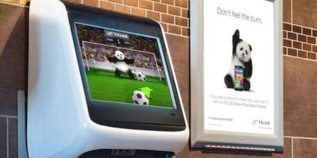 Telus' Urinal Ad Puts World Cup Fever In Your