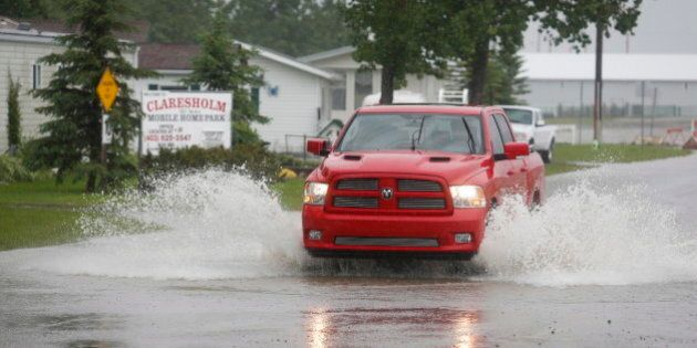 Alberta Flooding 2014: Some Evacuations, While Others Hold