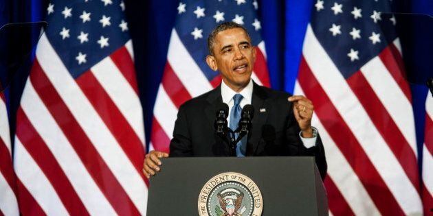 U.S. President Barack Obama speaks at the Department of Justice in Washington, D.C., U.S., on Friday,...