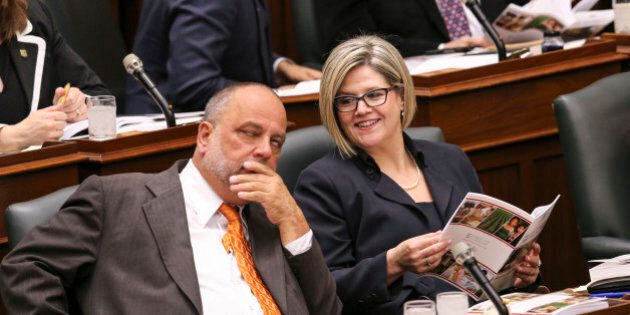 TORONTO, ON- MAY 1 - NDP leader Andrea Horwath talks with seat mate Gilles Bisson while Ontario Minister...
