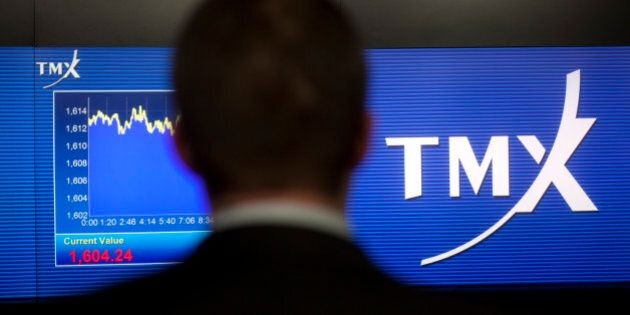 Kris Backus, manager of the TMX Broadcast Centre, checks a screen displaying TMX Group Inc. signage and...