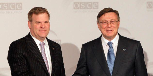 Canada's Minister of Foreign Affairs John Baird, left, handshake with Ukrainian counterpart Leonid Kozhara...
