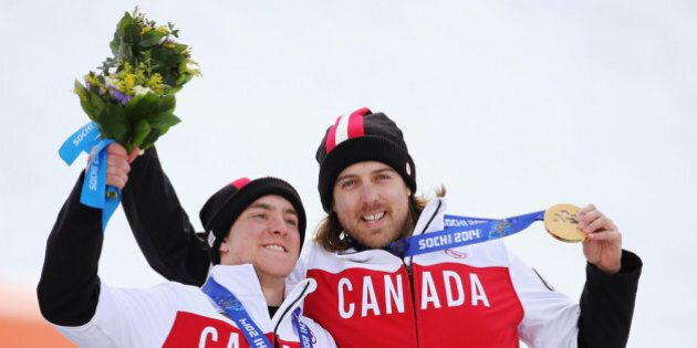 SOCHI, RUSSIA - MARCH 15: Gold medalist Mac Marcoux (L) of Canada and guide Robin Femy celebrate during...