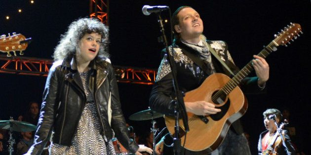 MOUNTAIN VIEW, CA - OCTOBER 26: Regine Chassagne (L) and Win Butler of Arcade Fire perform as part of...