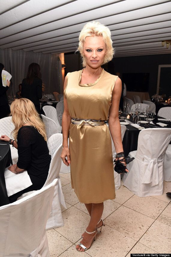 Pamela Anderson Wears An Unflattering Gold Outfit During Gala Dinner