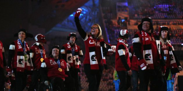 SOCHI, RUSSIA - MARCH 16: Canada team members enter the stadium prior to the Sochi 2014 Paralympic Winter...