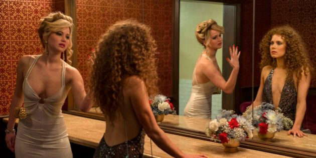 This photo released by Sony Pictures shows Jennifer Lawrence, left, as Rosalyn Rosenfeld, and Amy Adam...
