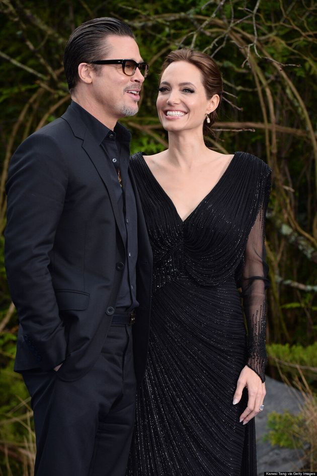 Angelina Jolie And Brad Pitt Get Hot And Bothered At 'Maleficent'