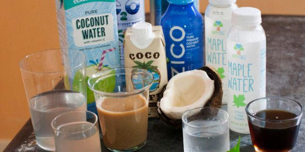 This June 9, 2014 photo shows an assortment of trending waters from left to right Trader Joe's pure coconut water, C2O pure coconut water, Coco Cafe vanilla coconut water cafe latte, Zico pure premium coconut water, O.N.E. coconut water, and Happy Tree maple water and maple syrup in Concord, N.H. Coconut water, maple water and a range of enhanced waters are being touted as a healthier alternative to sugary soda. (AP Photo/Matthew Mead)