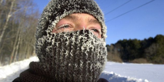 ** ADVANCE FOR MONDAY, MARCH 17 -- FILE ** Frost coats Ryan Douglas's eyelids and face mask as he jogs in subzero weather, Thursday, Feb. 13, 2003, in Freeport, Maine. This has been the coldest winter in Maine since 1993-94, but only the 12th coldest in the 63 years that the National Weather Service has kept records. (AP Photo/Robert F. Bukaty, files)