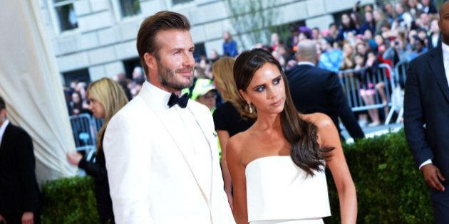 NEW YORK, NY - MAY 05: David Beckham (L) and Victoria Beckham attend the 'Charles James: Beyond Fashion'...