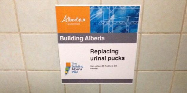 Wildrose Mocks 'Building Alberta' Ads With Faux Signs Celebrating Urinal Cakes