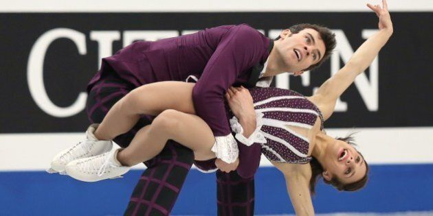Canada's pair Meagan Duhamel and Eric Radford perform during in the pairs free skating competition at...