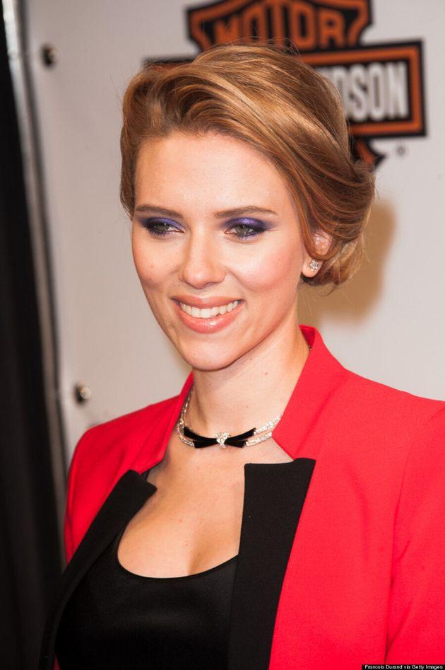 Scarlett Johansson Hides Baby Bump Under Chic Red Suit