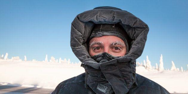 man bundled in winter coat in...