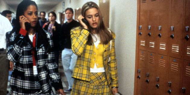 Stacey Dash and Alicia Silverstone walking and talking on their mobile phones in a scene from the film...