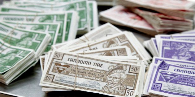 Canadian Tire Corp. money sits bundled together in stacks at a store in Toronto, Ontario, Canada, on...