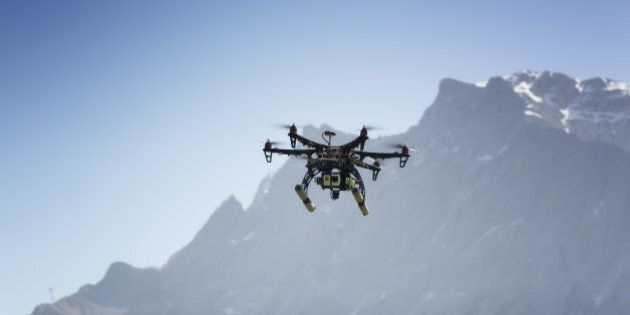 Drone flying with camera in mountain (Zugspitze)