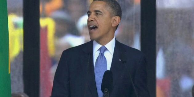 In this image from TV, US President Barack Obama speaks to the assembled crowds at the FNB Stadium in...