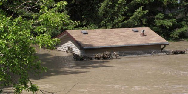 A house is submerged by flood water at a park near the Bow River in Calgary, Alberta, Canada June 22,...