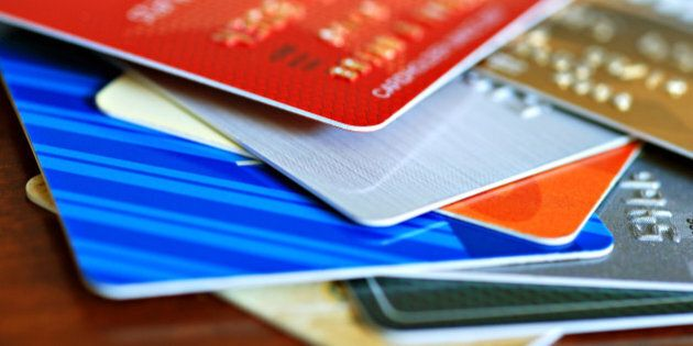 Colorful stack of credit cards and shopping gift cards. Macro with extremely shallow
