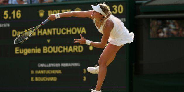 Canada's Eugenie Bouchard serves to Slovakia's Daniela Hantuchova during their women's singles first...
