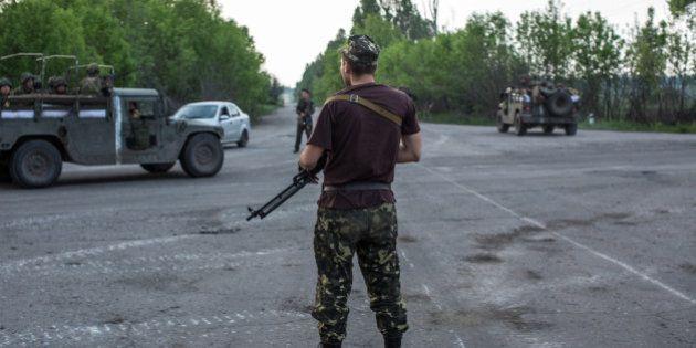 NOVATROIZK, UKRAINE - MAY 14: Ukrainian soldiers guard a checkpoint on May 14, 2014 in Novatroizk, Ukraine....
