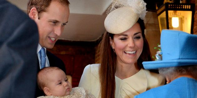 Britain's Queen Elizabeth II, right, speaks with Prince William and Kate Duchess of Cambridge as they...