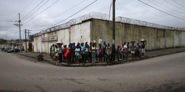 MONROVIA, LIBERIA - AUGUST 18: Local residents watch public health advocates stage street performances...