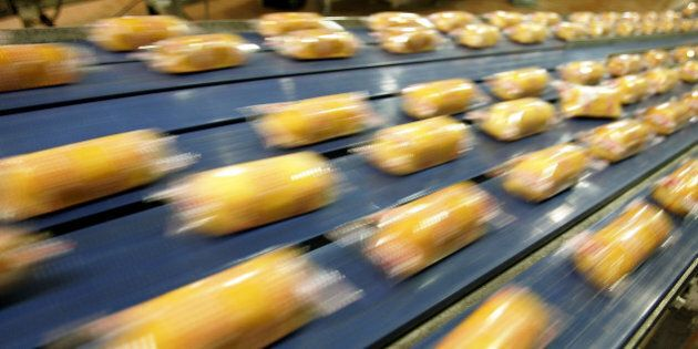 SCHILLER PARK, IL - APRIL 20: Hostess Twinkies move through the packaging process at the Interstate Bakeries...